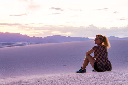 alamogordo: Silhouette of woman watching over White Sand Dunes during sunset