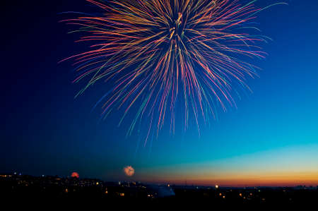 Brightly colorful fireworks and salute in the night sky Stock Photo