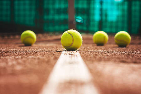 Tennis court line with balls Stock Photo