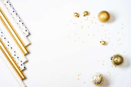Rolls of gold and white wrapping paper for gifts on white background