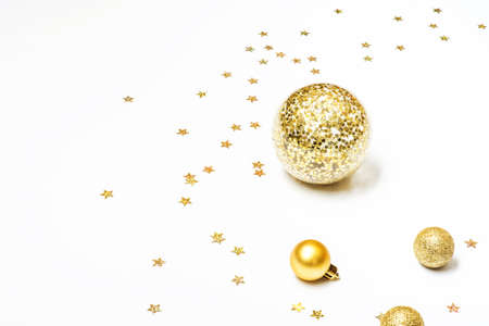 Gold Christmas balls on white background