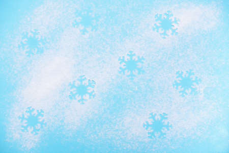 Snowflakes pattern on blue background. Christmas background concept