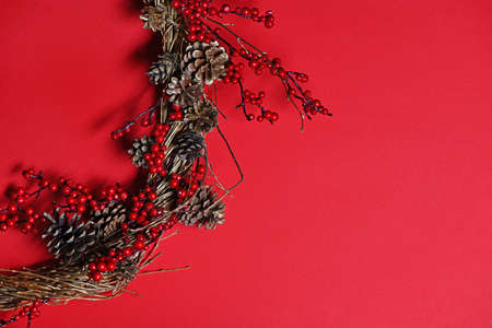 Handmade Christmas wreath on red background