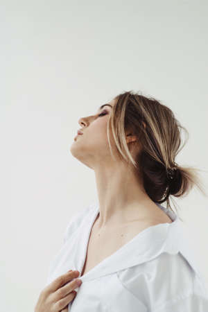 Young beautiful woman with closed eyes over white background.