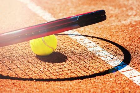 Green tennis ball on an outdoor tennis court