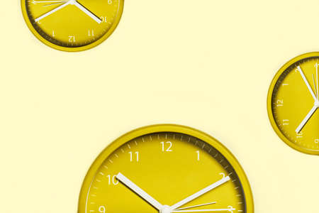 Creative background with yellow clocks. Time management concept.