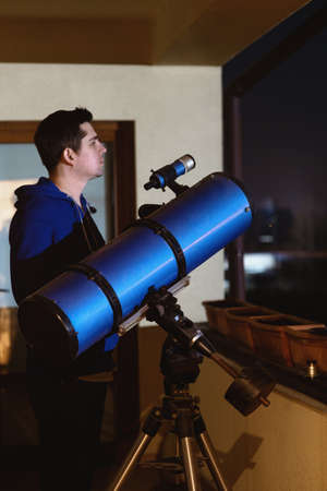 Man looking through telescope. Stok Fotoğraf