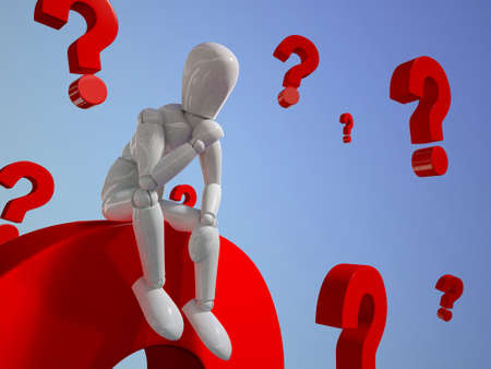A puppet is thinking in a pile of question marks photo