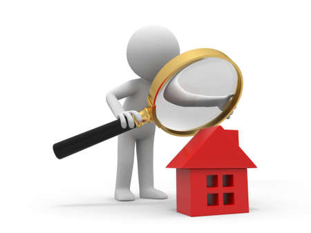 A person with a magnifying glass to check a house
