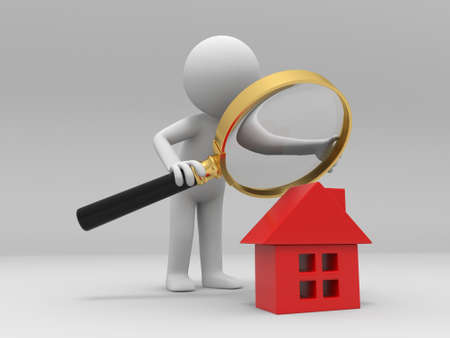 magnified: A person with a magnifying glass to check a house