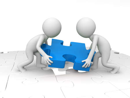 Teamwork Two people are moving a piece of the puzzle Stock Photo