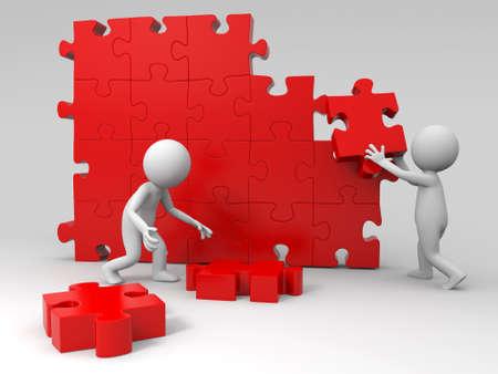 grupo de personas: Trabajo en equipo Dos personas se están moviendo los puzzles