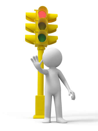 Traffic light a man stand ,a traffic light behind photo