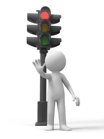 señales de transito: Semáforo un hombre de pie, detrás de un semáforo Foto de archivo