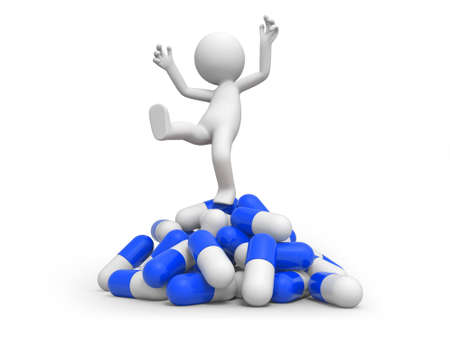 A 3d person standing on a pile of capsules photo