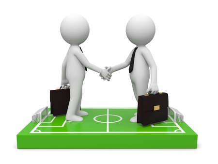 focus on the goal: Two 3d businessmen shaking hands on a football field model Stock Photo