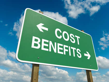 A road sign with cost benefits words on sky background photo