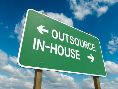 A road sign with outsource inhouse words on sky background