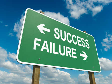 A road sign with success failure words on sky background photo