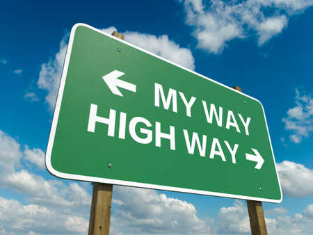 A road sign with my way high way words on sky background photo