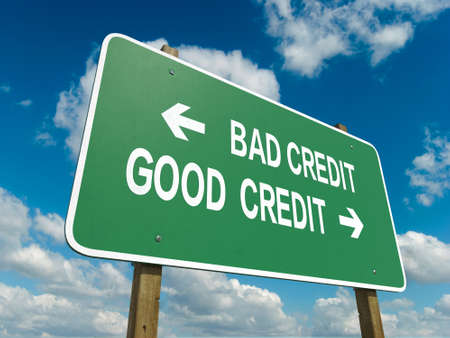 A road sign with bad credit good credit words on sky background Stockfoto