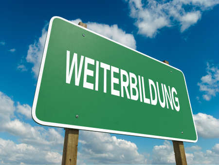 A road sign with weiterbildung words on sky background photo