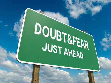 A road sign with doubt fear words on sky background photo
