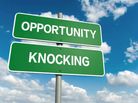 A road sign with opportunity knocking words on sky background photo