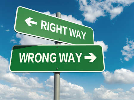 wrong way: A road sign with right way wrong way words on sky background Stock Photo