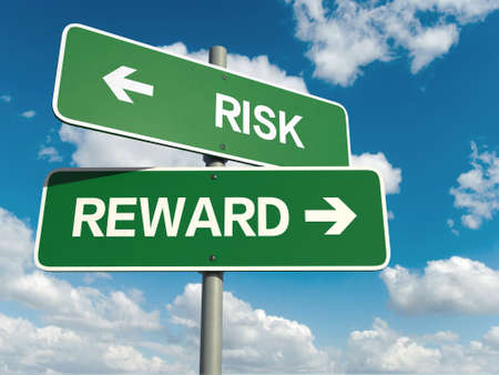 rewards: A road sign with risk reward words on sky background