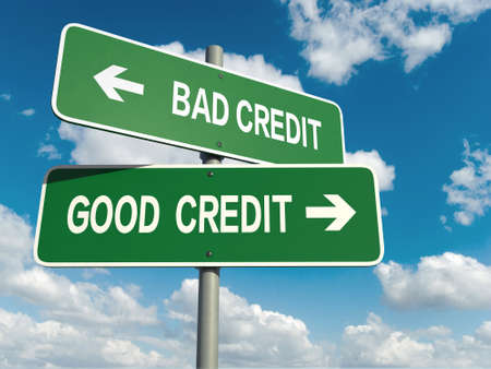 A road sign with bad credit good credit words on sky background Imagens
