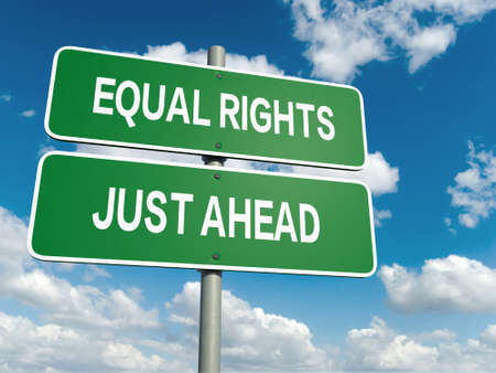 equal: A road sign with equal rights words on sky background Stock Photo