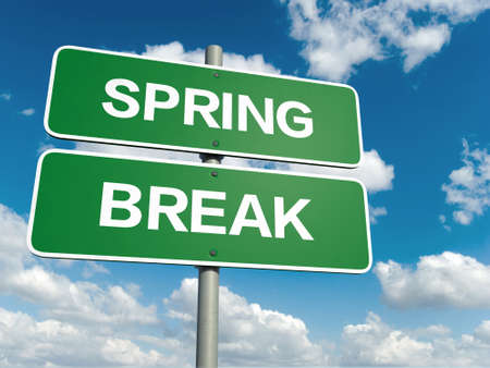 A road sign with spring break words on sky background photo