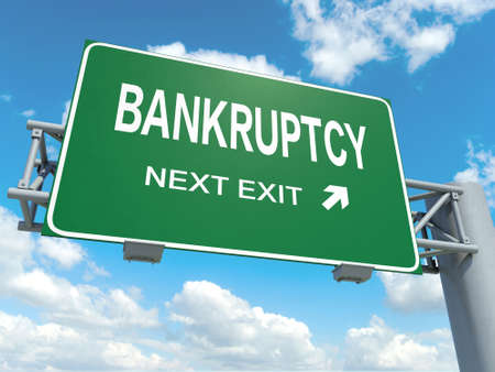 A road sign with bankruptcy words on sky background Imagens