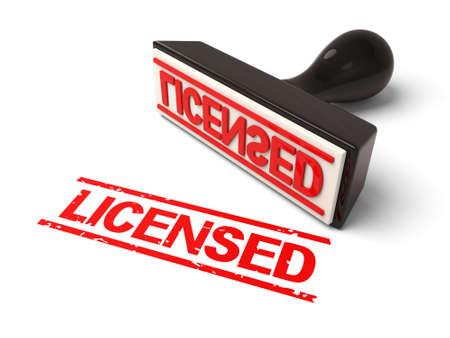 licensed: A rubber stamp with licensed in red ink.3d image. Isolated white background.