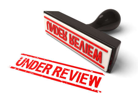 reviews: A rubber stamp with under review in red ink.3d image. Isolated white background.
