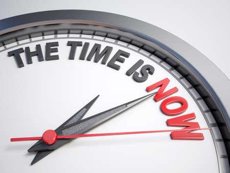 Tiempo: Reloj con palabras el momento es ahora en su cara Foto de archivo