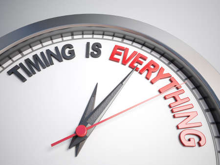 timing: Clock with words timing is everything on its face Stock Photo