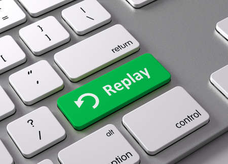 Eine Tastatur mit einem grünen Knopf-Replay Standard-Bild - 48964898