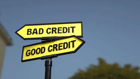 A road sign with bad credit and good credit words Stock fotó