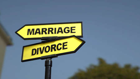 A road sign with marriage  divorce words