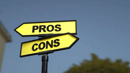A road sign with pros  and cons words.