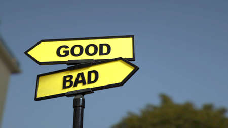 A road sign with good and bad words Stock fotó