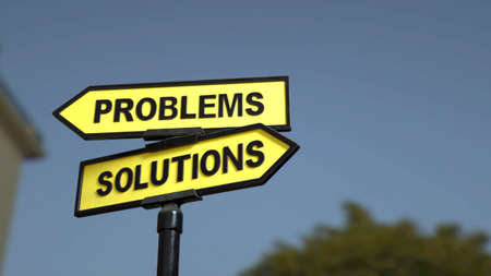 A road sign with Problems and  Solutions words