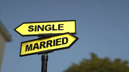 A road sign with single and  married words. Stock fotó