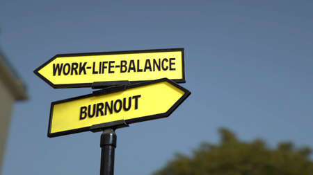A road sign with work-life-balance  and burnout words