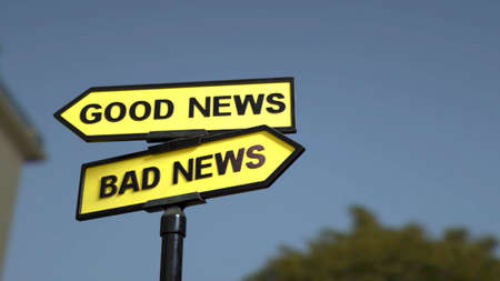A road sign with good news and  bad news words
