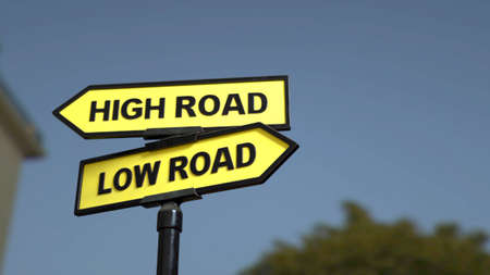 A road sign with high road  and low road words