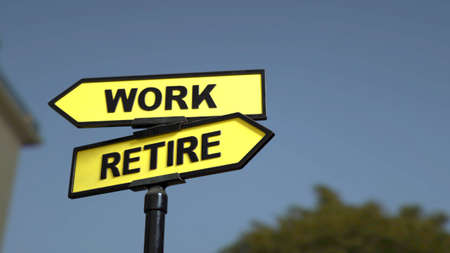 A road sign with work  and retire words