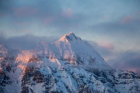 Mountain portrait Birnhorn Saalbach sunset purple light clouds